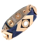 SNAKE PRINT LEATHER WRISTBAND WITH GOLD HARDWARE AND CRYSTALS.